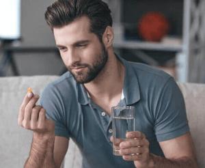 Man takes Levitra tablet